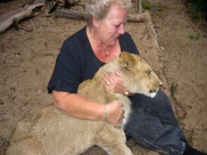 Woman with lion in Africa